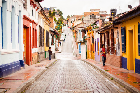 colonial building: Downtown street up hill with colorful houses