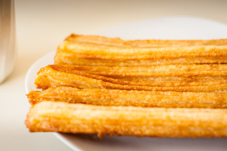 Several churros on small plate Banque d'images