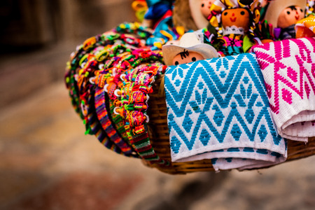 Basket of traditional dolls and mexican crafts 스톡 콘텐츠