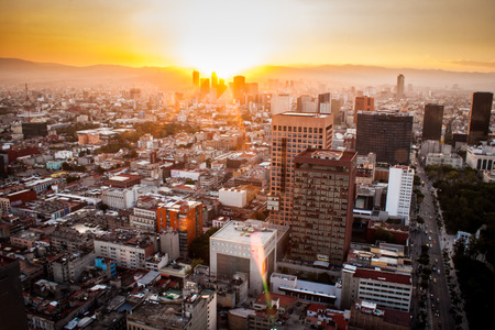 Aerial view of mexico city at sunset Редакционное