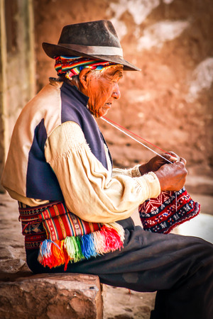 Old men knitting at taquile island in puno peru Stock Photo