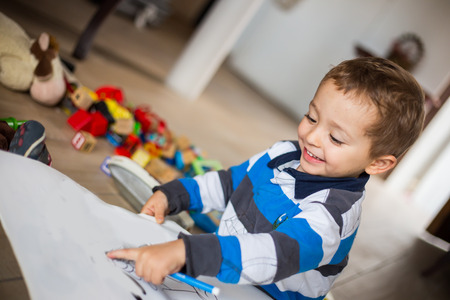 color image creativity: Happy cheerful child drawing at home. Creativity concept.. Stock Photo