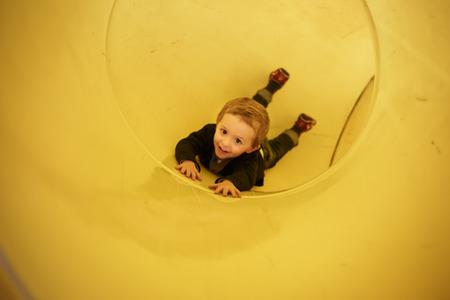 merry go round: happy little boy on the playground.