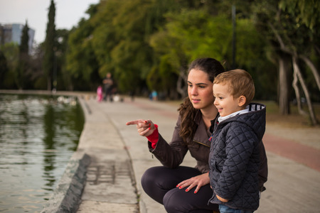 Picture of hugging mother and son in a lake photo