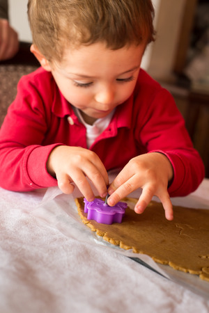 pastry cutter: Little boy child baby, baking making cookies. Stock Photo