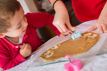 3 year old boy: Little boy child baby and mom, baking making cookies. Stock Photo