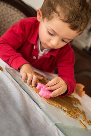 Little boy child baby, baking making cookies. Stock Photo