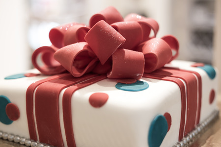 fondant fancy: Fondant cake red and white. Stock Photo