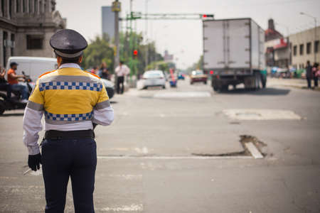 Traffic cop checking the traffic in mexico city.