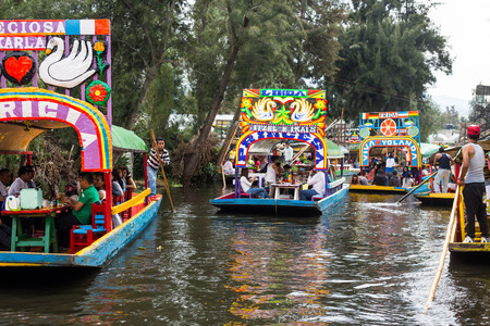 Mexico City, Mexico, August.22. 2015: Colourful Mexican gondolas at Xochimilcos Floating Gardens in Mexico City.