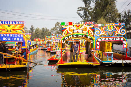 Mexican workers painting colorful trajineras boats in xochimilco, Mexico City, Mexico. 2016-12-19.