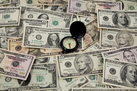 compass on dollar bills photo