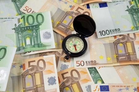 euro banknotes and compass photo