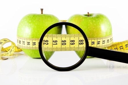 two apple meter and magnifying glass photo