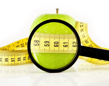 apple meter and magnifying glass photo