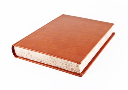 Great Book with orange leather binding on a white background. Stock Photo