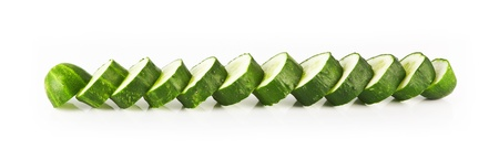 Cucumber pieces, arranged in order of each other on a white background.