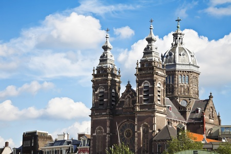 Church of St. Nicholas in Amsterdam, the blue sky and some clouds, the Netherlands, Europe.