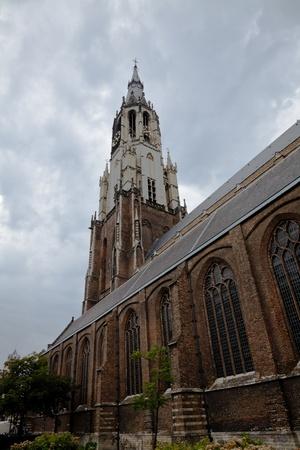 westerkerk: The Nieuwe Kerk - New Church in Delft in the Netherlands and cloudy sky.