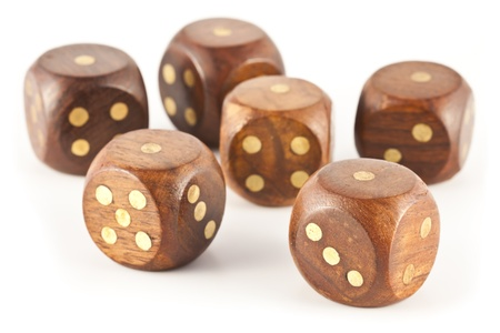 Aces obtained on six wooden dice gambling on a white background.