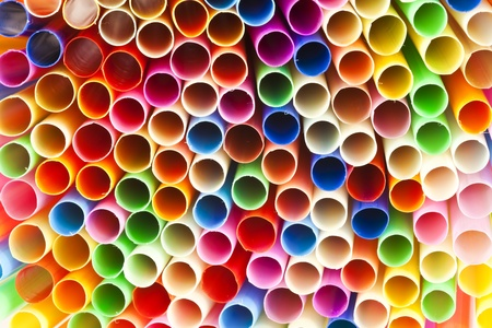 suck: Colourful straws, red, green, blue, yellow, orange, pink  arranged side by side.