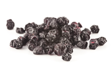 A few dried blueberries scattered on a white background.