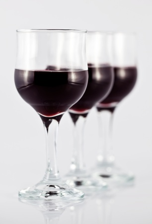 winetasting: Three glasses of red wine, with a focus on the first glass.