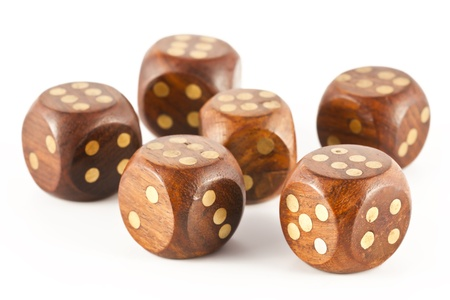obtained: Sixes obtained on six wooden dice gambling on a white background.