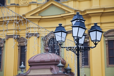 saint george: The old wrought-iron lanterns in front of the Cathedral of Saint George in the square in Timisoara, Romania. Stock Photo
