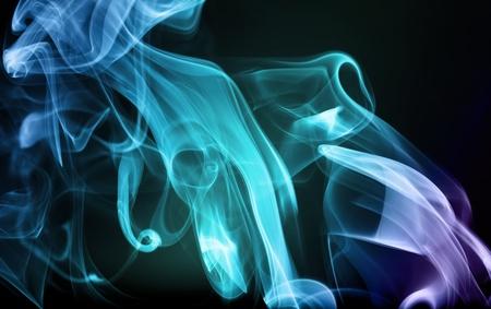 Blue green purple smoke swirling on a black background.
