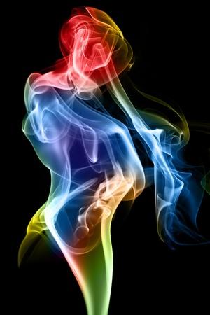 rainbow: Female figure formed of fine smoke on a black background.