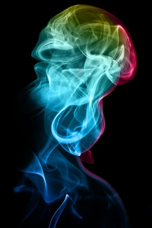 Colorful jellyfish formed by smoke on a black background.