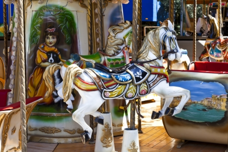 carousel horse: Old, colorful wooden horse in an amusement park