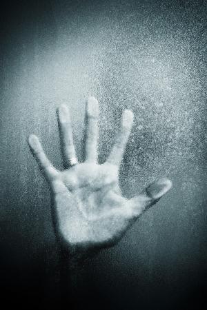A handful of leaning on sandblasted glass plate  版權商用圖片