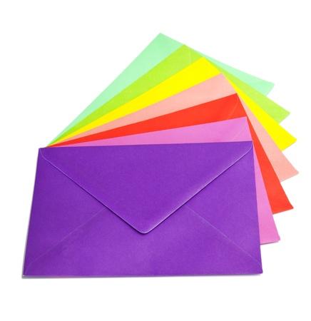 envelope decoration: Several colorful envelopes arranged on a white background