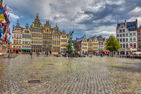 square image: ANTWERP, BELGIUM, AUGUST 23, 2011 Great Market Square.  Great Antwerp square, a fountain, tourists and beautiful old buildings, HDR Image.