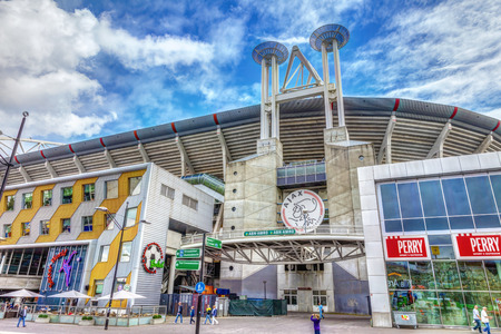 ajax: Amsterdam, The Netherlands - August 16. 2011.: Exterior soccer stadium Ajax Arena. One of the entrances to the stadium of the football club Ajax, HDR Image.