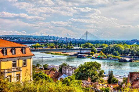 SERBIA, BELGRADE - JULY 26: Bridges of Belgrade from the Kalemegdan Fortress on July 26, 2017 in Belgrade. Sava River, bridges and a view of Belgrade, HDR Image.