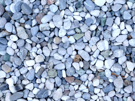 Blue and white river gravel - background texture