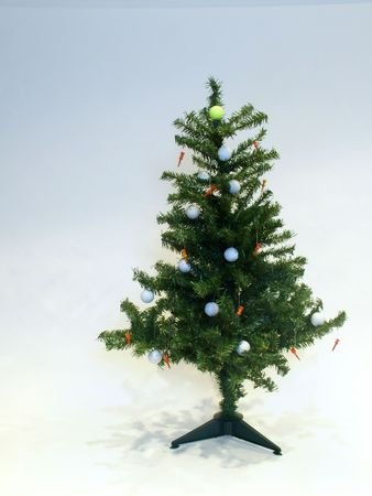 christmas golf: Christmas tree decorated with golf balls and tees Stock Photo