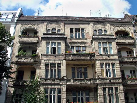 crumbling: A still-inhabited crumbling stone apartment building in Berlin, Germany