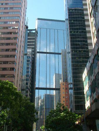 apartment shortage: Looking up at reflections in Hong Kongs skyscrapers