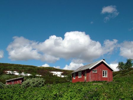 mountainside: Two Simple Mountain Cabins in Norway Stock Photo
