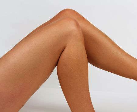 Smooth tanned legs against a white backdrop Stock Photo - 2102998