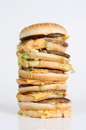 large size: A huge towering burger with dripping cheese Stock Photo