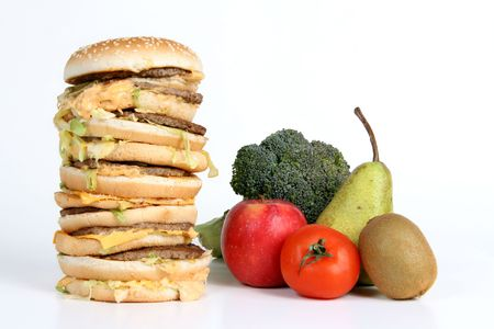 health choice: A huge burger next to fruit and vegetables