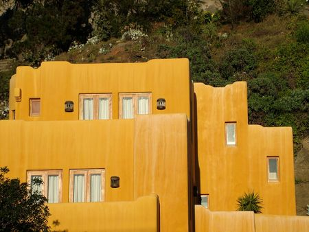 Terracotta colored house with a Mexican design photo