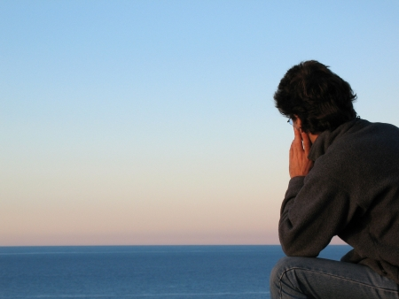 rejection sad: A lonely man looking out to sea