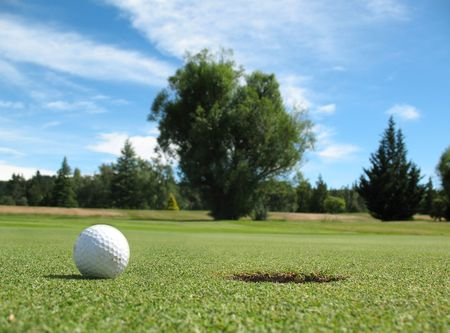 A golf ball close to the hole Stock Photo - 4709139