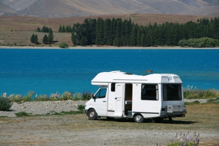 recreational vehicle: Pure white motorhome parked at the lakes edge in Tekapo, New Zealand